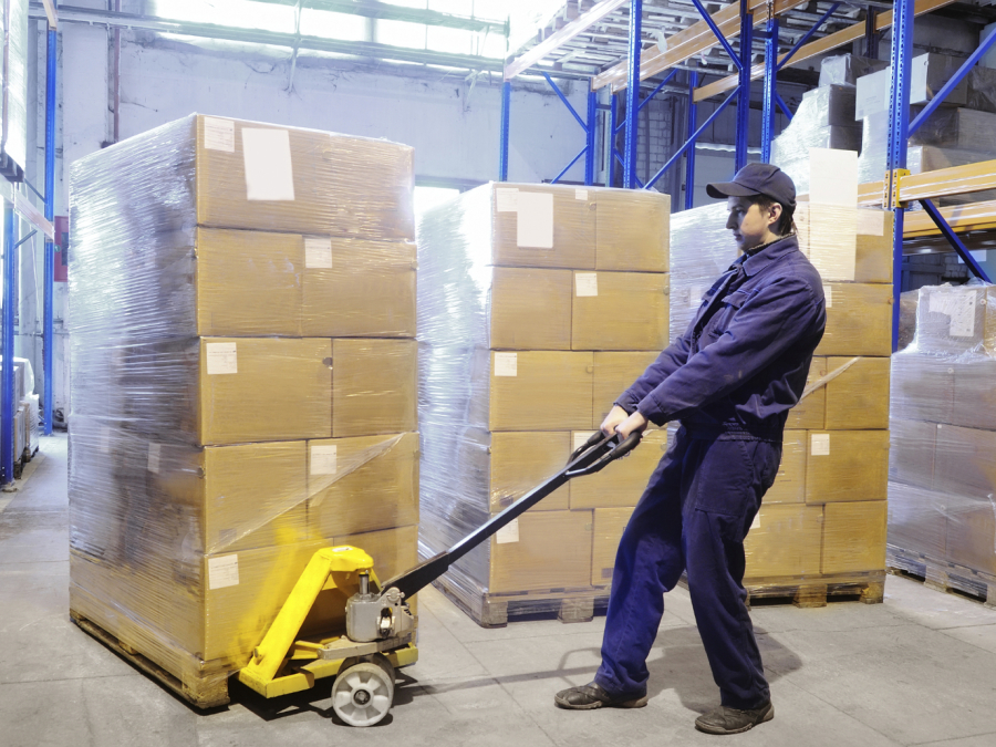 Warehouse worker moving large loads